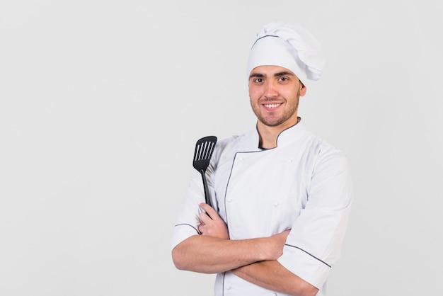 Portret van chef-kok met spatel Gratis Foto