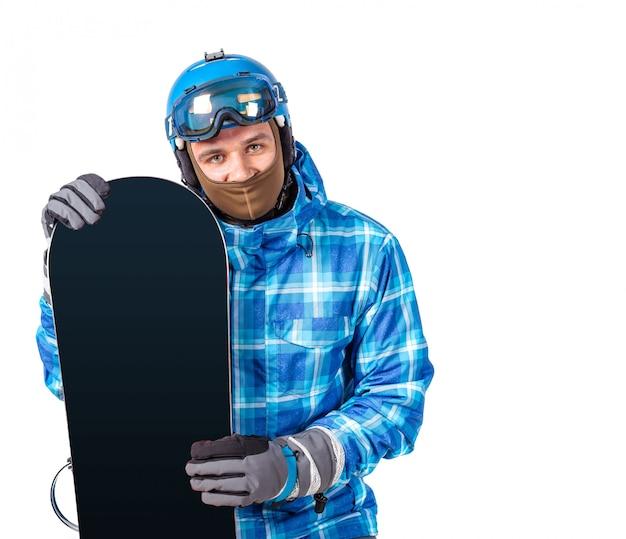 Portret van de jonge die mens in sportkleding met snowboard op een wit wordt geïsoleerd. Premium Foto