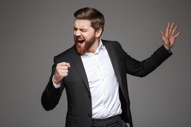 Portret van een grappige jonge zakenman Premium Foto