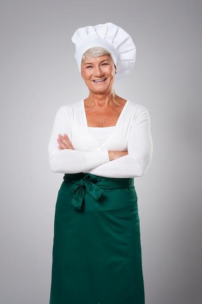 Portret van ervaren vrouwelijke chef-kok Gratis Foto
