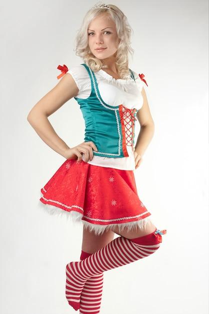 Portret van jonge sexy kerstmanvrouw Gratis Foto