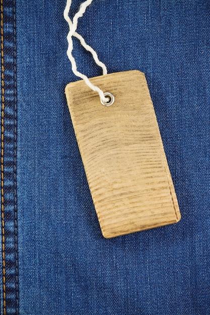Prijskaartje over jeans textuur Premium Foto