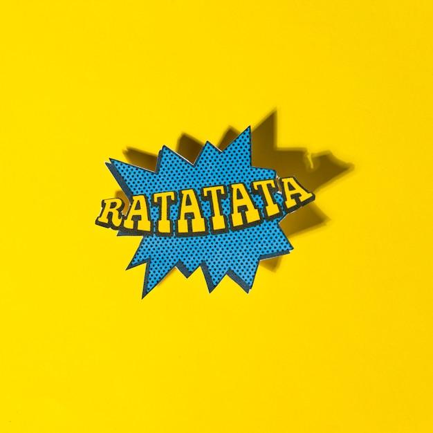 Ratatata-vector illustreerde de grappige uitdrukking van de boekstijl met schaduw op gele achtergrond Gratis Foto