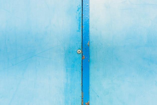 Regeling met blauwe oude muur Gratis Foto