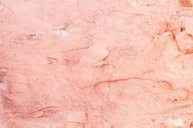 Regeling van roze geschilderde stenen om muren te maken Gratis Foto