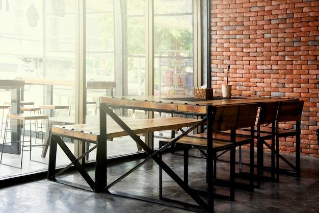 Restaurant en koffiewinkelkoffiebinnenland voor achtergrond. Premium Foto