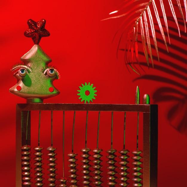 Rode abstracte kerst- en nieuwjaarssamenstelling met boom, klok, cadeau en telefoon. Premium Foto