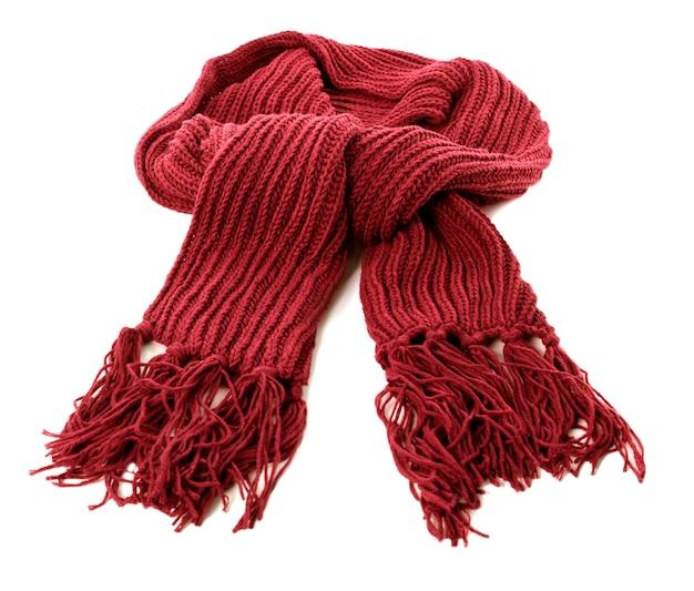 Rode de wintersjaal die op een witte achtergrond wordt geïsoleerd Gratis Foto