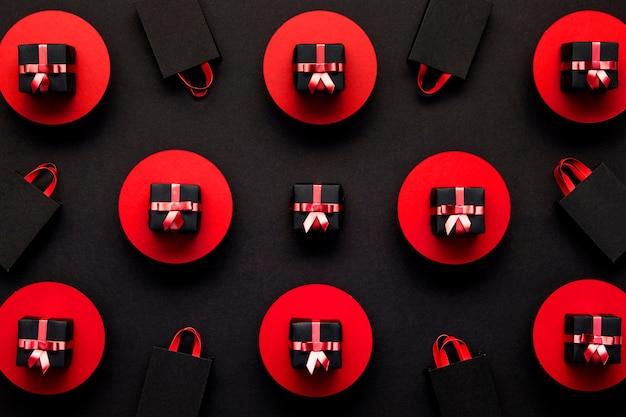 Rode en zwarte geschenkdozen achtergrond Gratis Foto