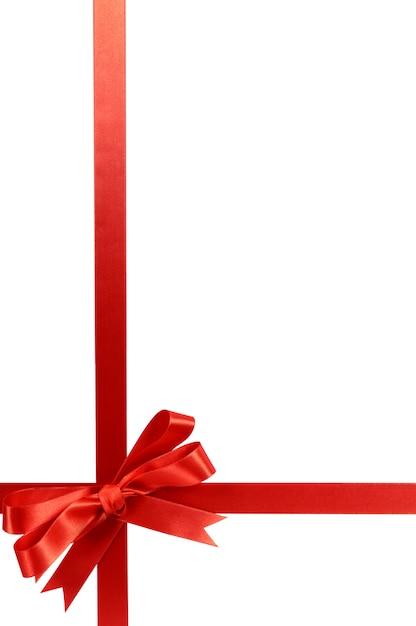 Rode gift lint boog verticale hoek grensframe geïsoleerd op wit. Premium Foto