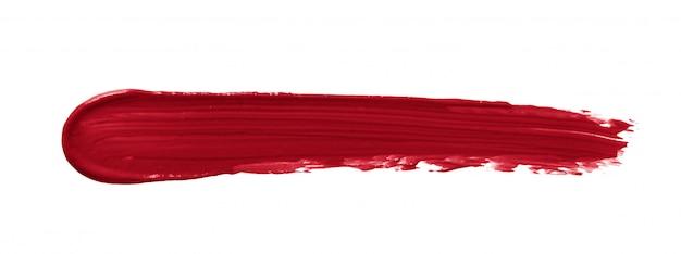 Rode lippenstiftvlek die op wit wordt geïsoleerd Premium Foto