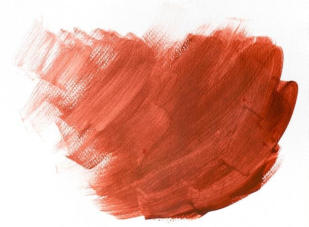Rode penseelstreek op witte achtergrond Premium Foto