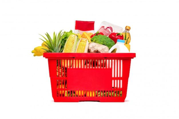 Rode winkelmandje vol met voedsel en boodschappen Premium Foto