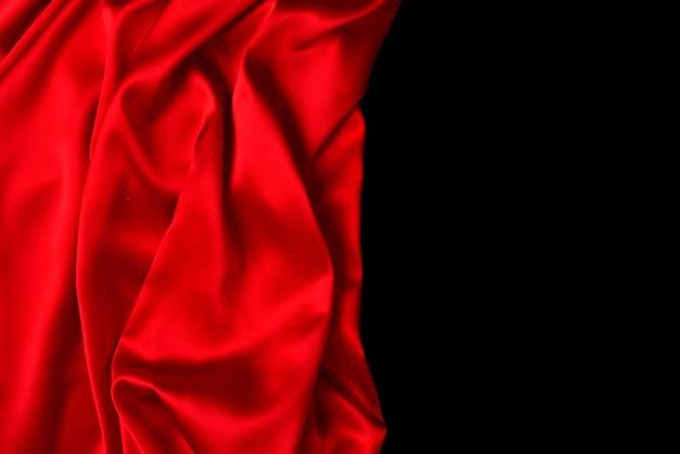 Rode zijde of satijn luxe stof textuur Premium Foto