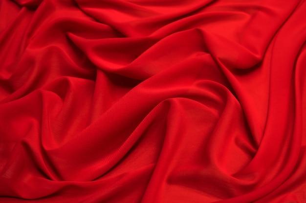 Rode zijde stof doek golven textuur. Premium Foto