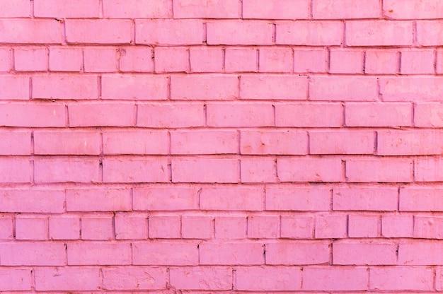 Roze bakstenen muurachtergrond Gratis Foto