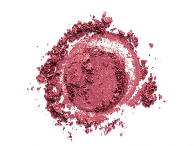 Roze bloost, oogschaduw rond monster dat op wit wordt geïsoleerd Premium Foto