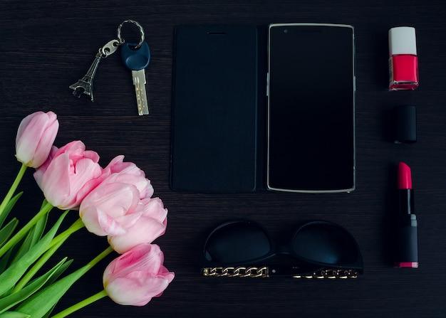 Roze en zwarte accessoires voor dames Premium Foto