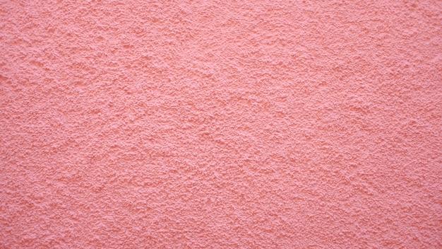 Roze muur textuur achtergrond Gratis Foto