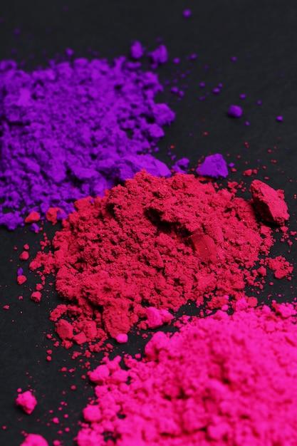 Roze, paars en rood poeder, holi festival concept Gratis Foto