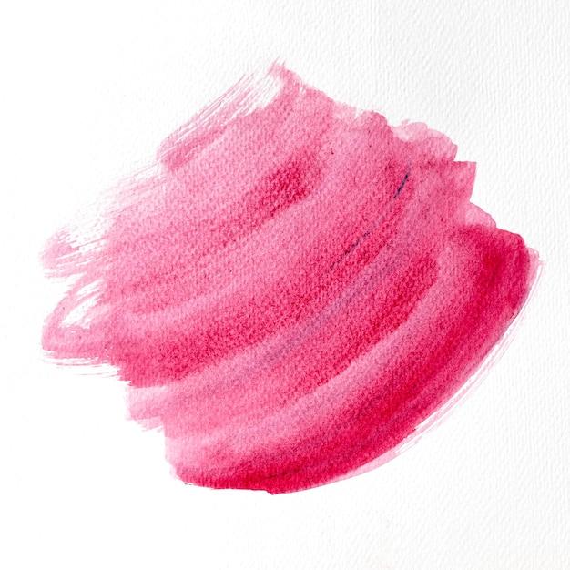 Roze penseelstreek op witte achtergrond Gratis Foto