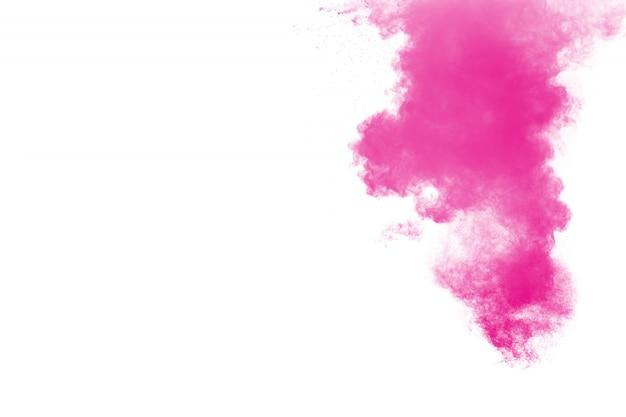 Roze poederexplosie op wit Premium Foto