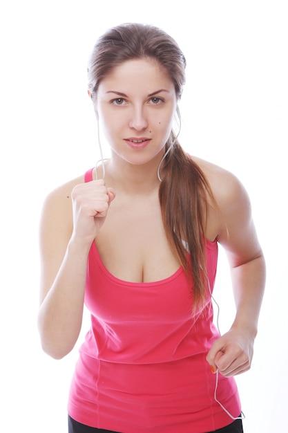 Running vrouw met koptelefoon Gratis Foto