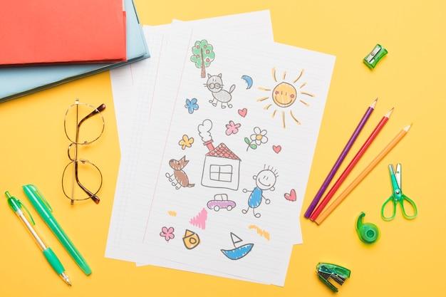 Samenstelling van schoolkantoorbehoeften met tekening Gratis Foto