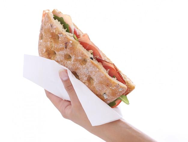 Sandwich in een hand Gratis Foto