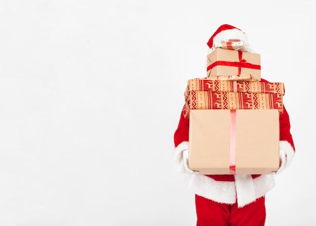 Santa claus met giften van kerstmis Gratis Foto