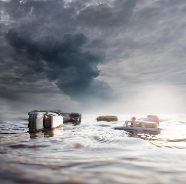 Scène van gecrashte auto's (miniatuur, speelgoedmodel) in overstroming van natuurrampen. selectieve aandacht. Premium Foto