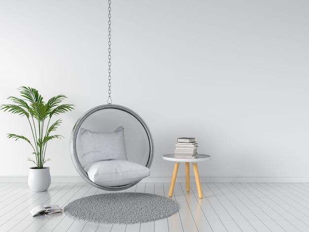 Schommeling en hoofdkussen in witte ruimte Premium Foto