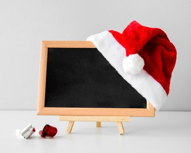 Schoolbordmodel en de hoed van santa Gratis Foto