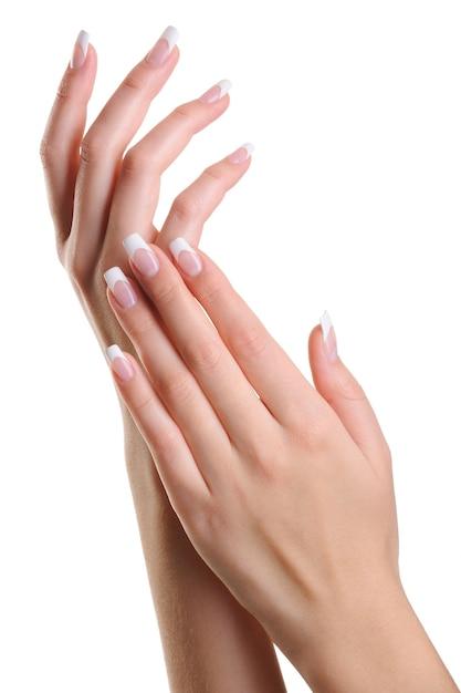 Schoonheid elegante vrouwelijke handen met franse manicure geïsoleerd op wit Gratis Foto