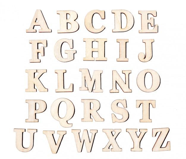 Set vintage houten letters, geïsoleerd op een witte achtergrond. Premium Foto