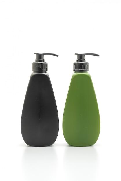Shampoo of haar conditioner fles op wit Premium Foto