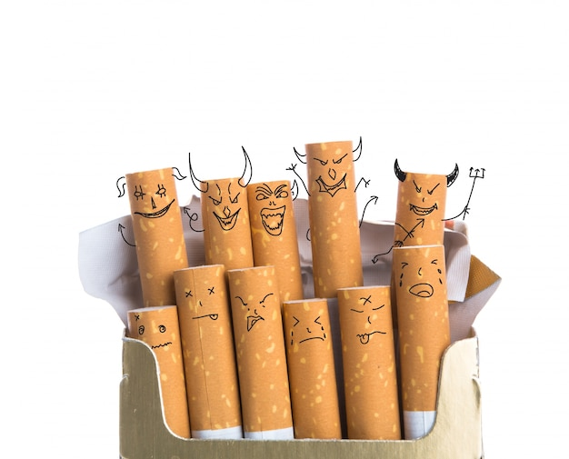 Sigaren met diabolische gezichten getrokken Gratis Foto