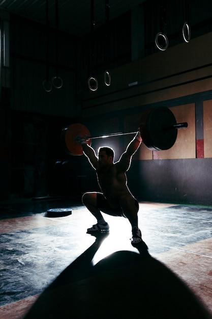 Silhouet van bodybuilder Gratis Foto