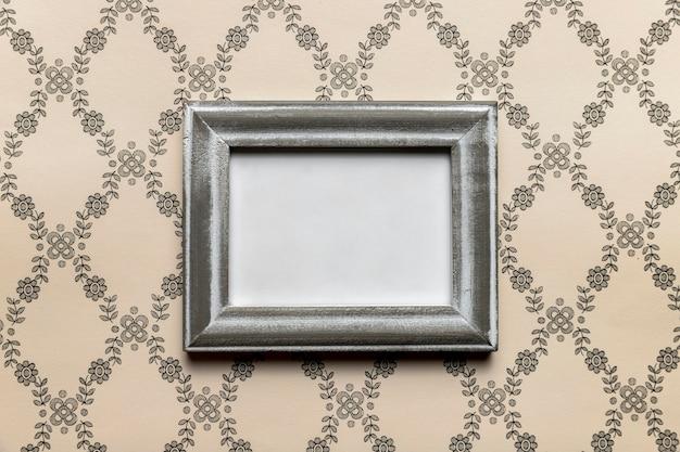 Simplistisch retro frame met patroonachtergrond Gratis Foto