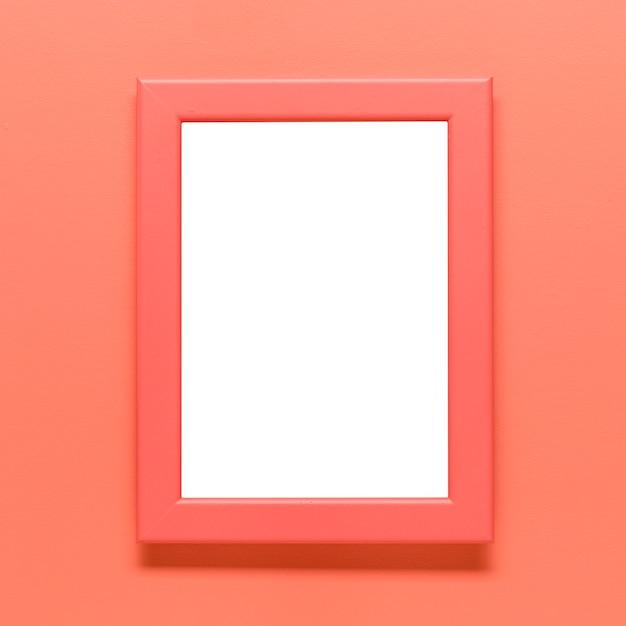 Sjabloon van leeg frame op gekleurde achtergrond Gratis Foto
