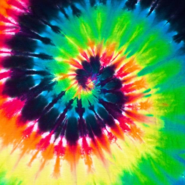 Sluit omhoog de kleurrijke achtergrond van de de stoffentextuur van de bandkleurstof Premium Foto