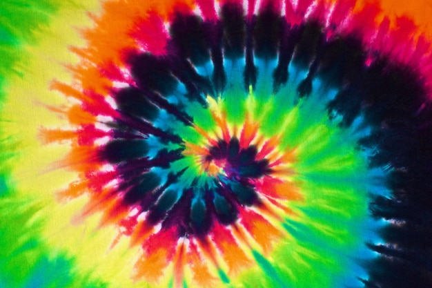 Sluit omhoog ontsproten van de kleurrijke achtergrond van de de stoffentextuur van de bandkleurstof Premium Foto