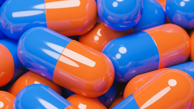 Sluit omhoog van vele oranje en blauwe pillencapsules Premium Foto