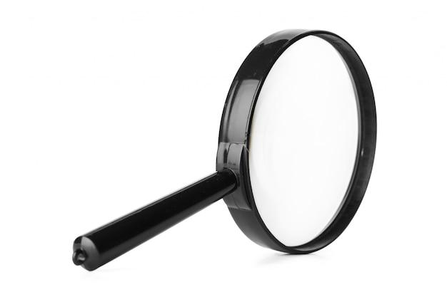 Sluit omhoog van vergrootglas op witte achtergrond wordt geïsoleerd die Premium Foto