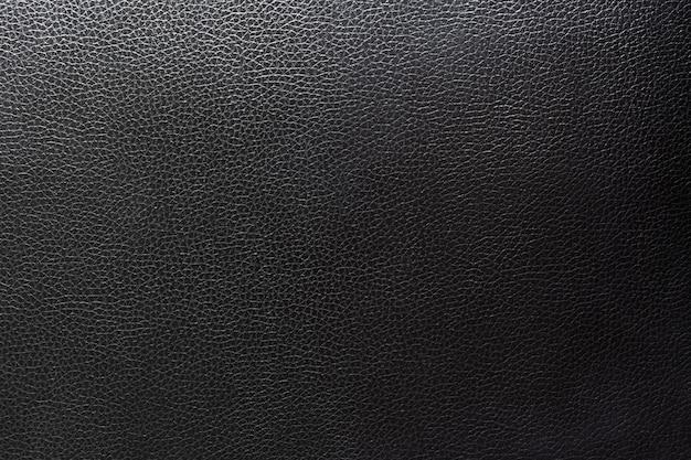 Sluit omhoog zwart leer en textuurachtergrond. Premium Foto