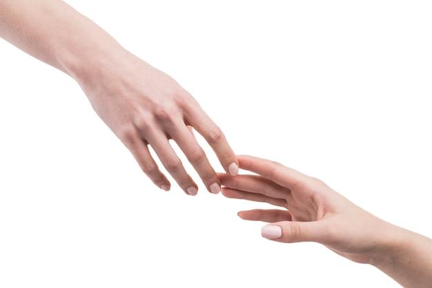 Snijd hand die elkaar bereikt Gratis Foto