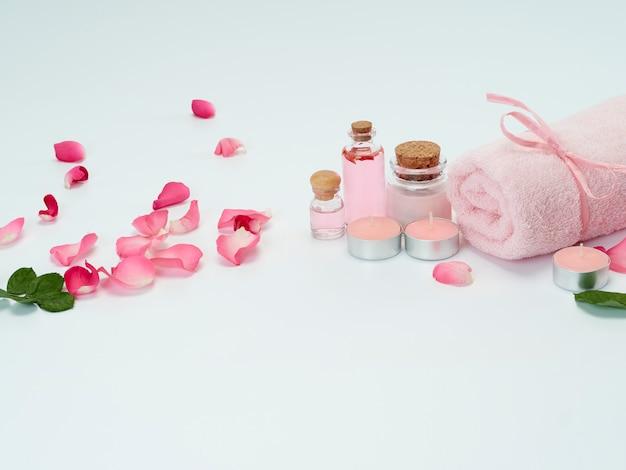 Spa set rozenolie en geurkaarsen Premium Foto