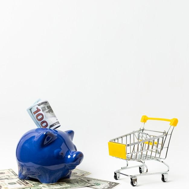 Spaarvarken besparingen voor winkelen concept Gratis Foto