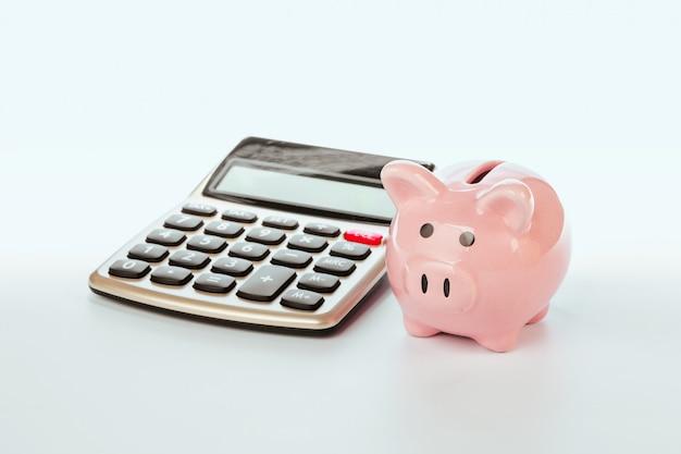 Spaarvarken met calculator Premium Foto