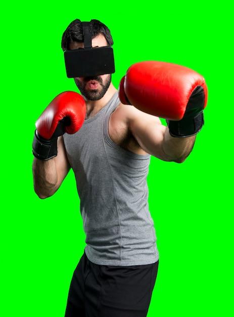 Sportman met bokshandschoenen en vr-bril Gratis Foto